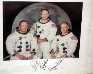 NASA Official 1969 Photo Signed By the Entire Crew of Apollo 11 in Their Space Suits Without Helmet, the Moon in the Background.